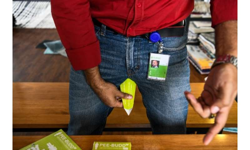 Founder of 'Pee Buddy' Deep Bajaj shows how to use a portable female urination device