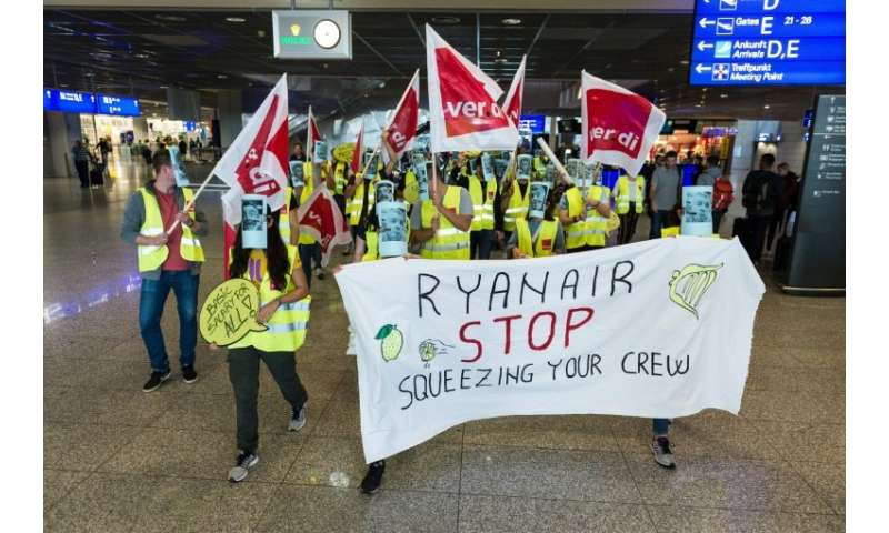 German employees of Irish airline Ryanair demonstrate at Frankfurt airport on September 12, 2018