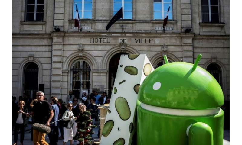 Google's Android operating system, a mascot of which is seen in this 2016 photo, has been the target of a long-running antitrust