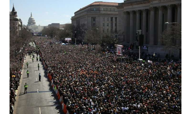 Gun reform advocates line Pennsylvania Avenue while attending the March for Our Lives rally March 24, 2018 in Washington, DC