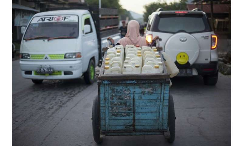 Hasria earns about $7 selling the 200 jerry cans of clean water she collects every day