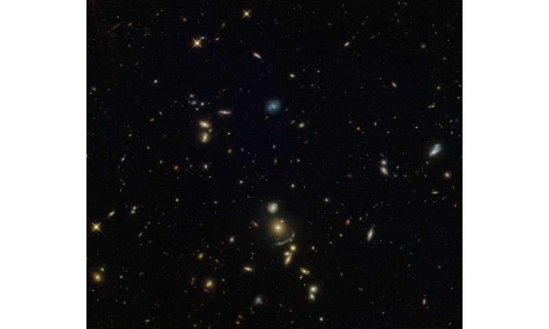 Hubble spots a green cosmic arc