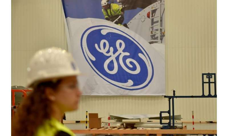 -Industrial giant General Electric is considering breaking up into separate operating units, the company's chief announced