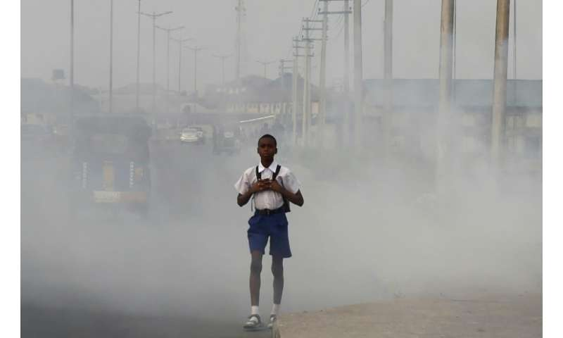 """In Port Harcourt—once dubbed """"The Garden City"""" because of its palm trees and green open spaces—black soot has fallen f"""