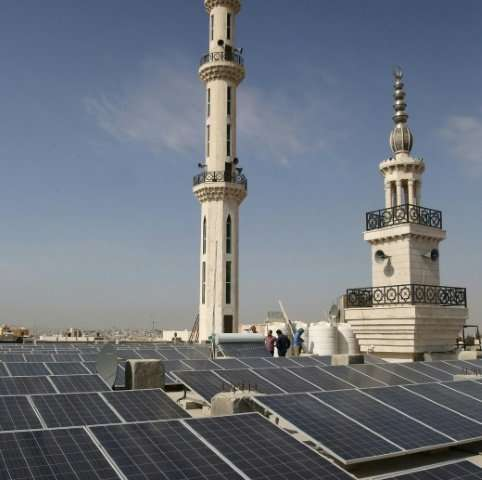 Jordanians hope solar panels like these on a mosque in Amman will help the country reduce its reliance on imported fossil fuels