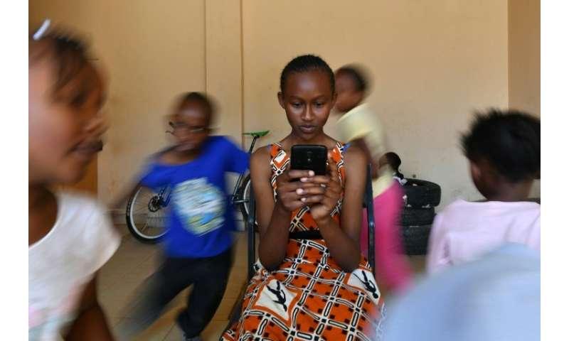 Kenyan schoolgirl Imelda Mumbi uses Eneza, an interactive educational app which has about three million users worldwide