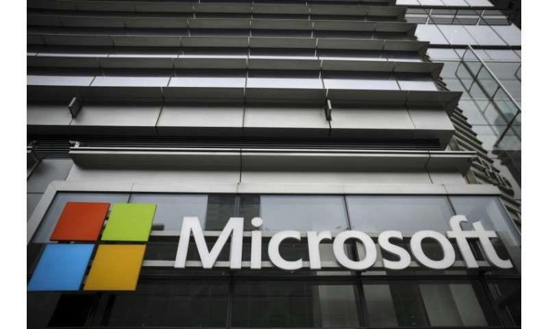 Microsoft hit an overall market capitalization of $812.9 billion, just ahead of Apple's $812.6 billion