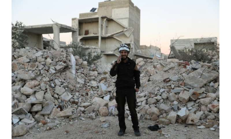 """Mohammed Hamroush, a member of the """"White Helmets"""" in Syria uses an app on his smartphone to track bombardments"""