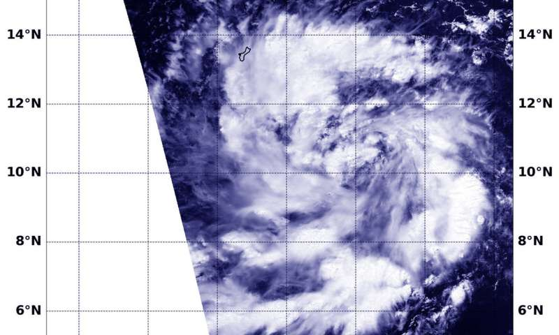 NASA sees tenth tropical depression form in northwestern Pacific, Guam posts warnings