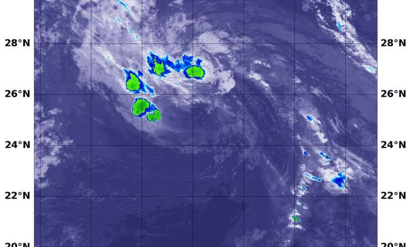 NASA tracks a fragmented, weaker Tropical Storm Hector into Northwestern Pacific