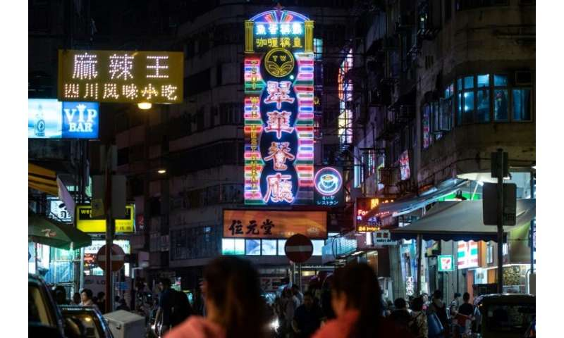 Neon has come to define the urban landscape in Hong Kong, with huge flashing signs protruding horizontally from the sides of bui