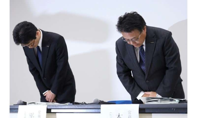 Nissan vice president Seiji Honda (R, with vice president Teiji Hirata) says the company will work hard to regain trust