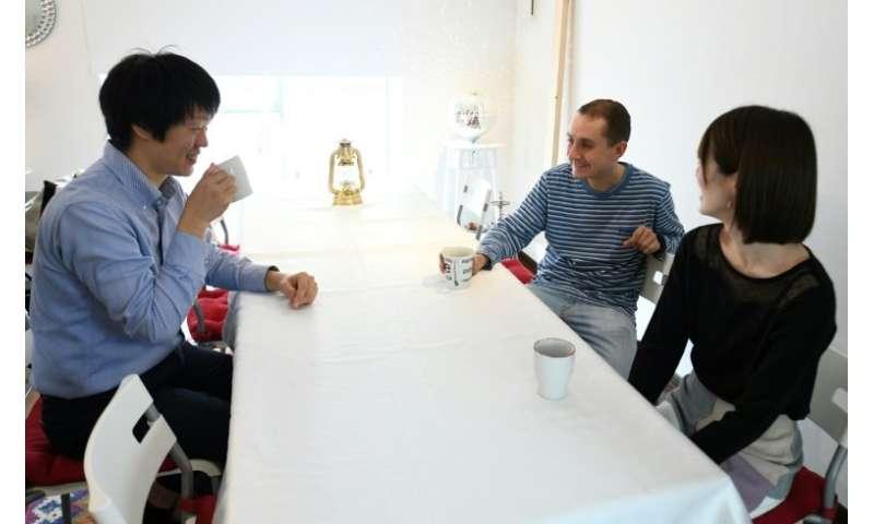 Nobuhide Kaneda (left) rents his apartment to Max Ikeda (back right), a Ukrainian-Japanese living in Hiroshima