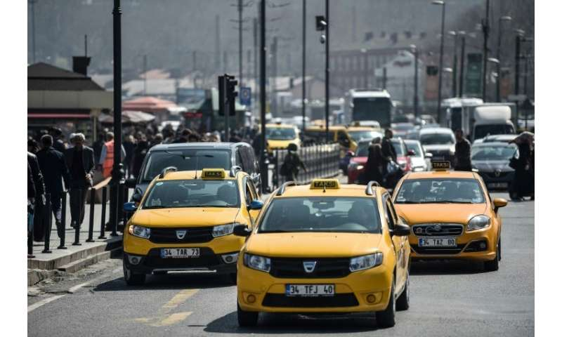 "Official yellow taxis wait for customers in Istanbul where President Recep Tayyip Erdogan says rival ride-app Uber is ""fini"