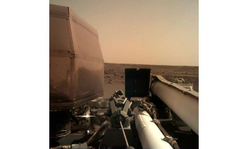 One of the first images taken by the Mars InSight lander and released by NASA after the probe landed on the surface of the Red P