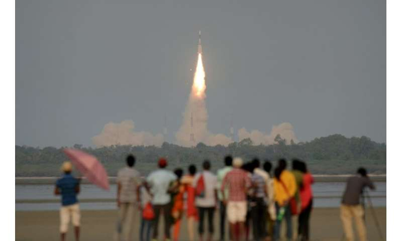 Onlookers watch as the  GSAT-6A communications satellite is launched