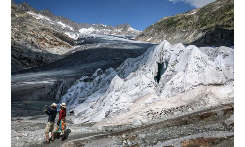 Part of the Rhone Glacier is covered with insulating foam to prevent it from melting during the August 2018 heatwave that swept