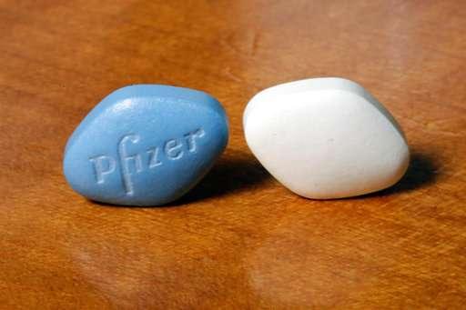 Pfizer's Q1 net jumps 14 pct., sales just miss expectations