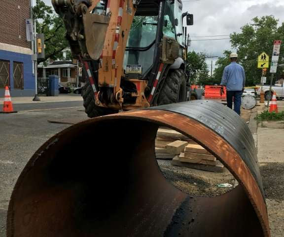 Philadelphia Gas Works workers replace cast iron gas mains with stainless steel pipes to reduce methane leaks in north Philadelp