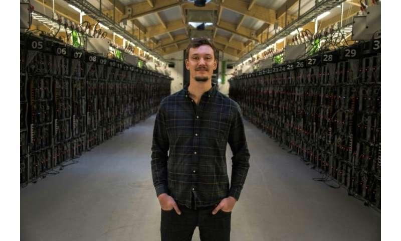"Philip Salter, head of operations at Genesis Mining, inside the company's bitcoin ""farm"""