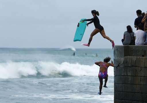 Powerful Hawaii hurricane downgraded to tropical storm