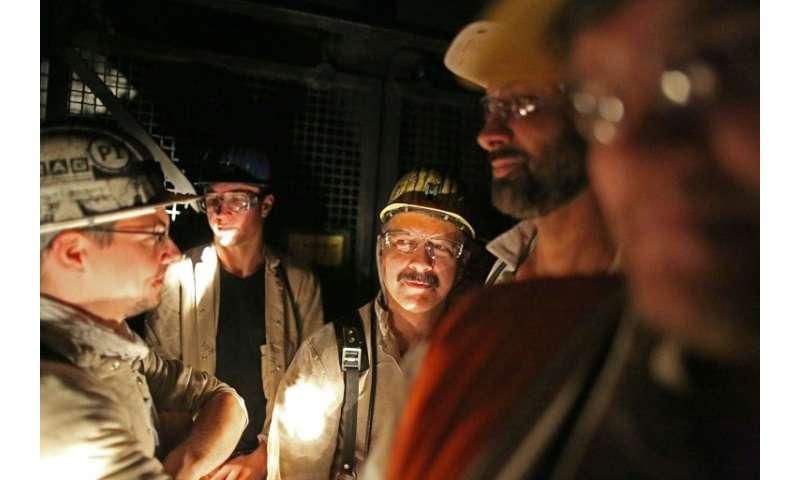 Prosper-Haniel miners riding in the shaft elevator in June