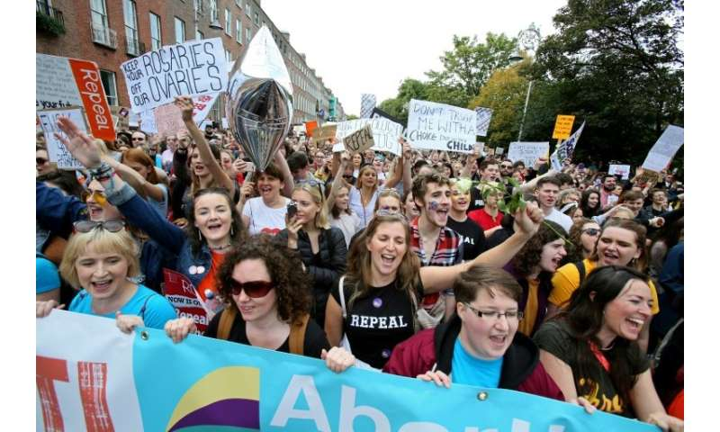Protesters hold up placards as they take part in the March for Choice, calling for the legalising of abortion in Ireland after t