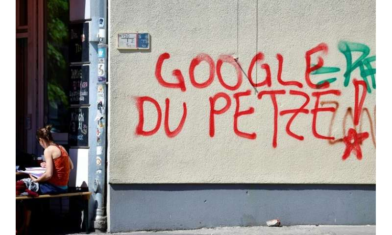 """""""Google, you snitch!"""" reads this graffiti, which appears to accuse the tech giant of passing on information to securit"""