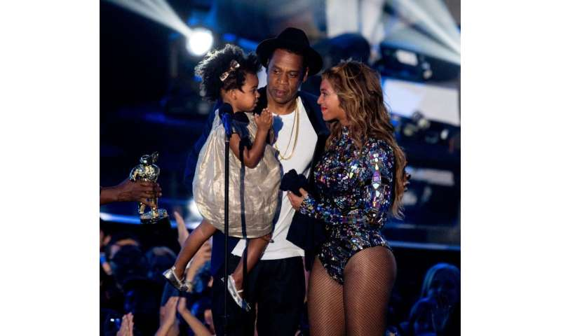 Rapper Jay-Z and singer Beyonce, pictured in 2014 with their daughter Blue Ivy Carter, marry their two musical styles on a surpr