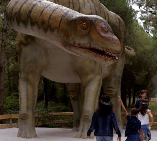 Resin statues are dotted throughout a forest route guiding visitors through the eons when dinosaurs stalked the Earth