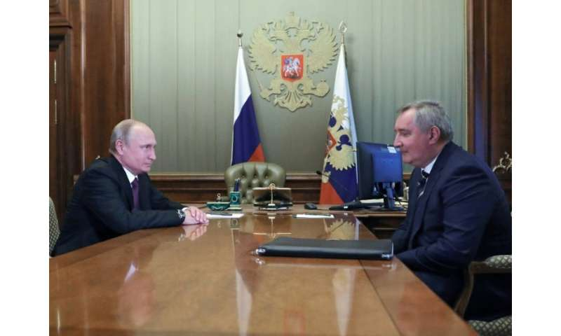 Russian President Vladimir Putin (left) meets appointed former deputy prime minister Dmitry Rogozin to head the country's space