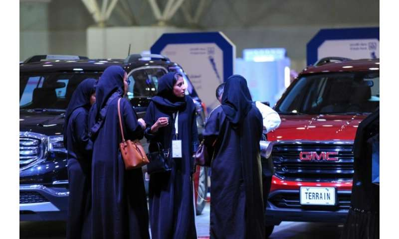 Saudi women attend an automotive exhibition for women in the capital Riyadh on May 13, 2018