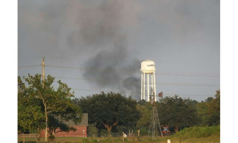 Smoke rises from the Arkema chemical manufacturing and storage facility that burst into flames after Hurricane Harvey's floodwat