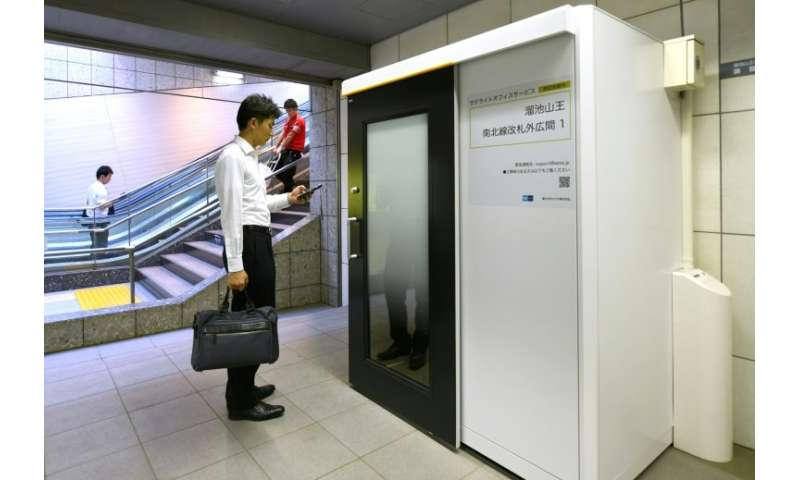 Some stations on Tokyo's metro now boast office cubicles equipped with desk, chair, computer display and wifi