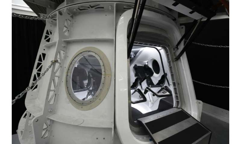 SpaceX will use its Falcon 9 rocket to launch its Crew Dragon capsule - simulator pictured here - to the orbiting International