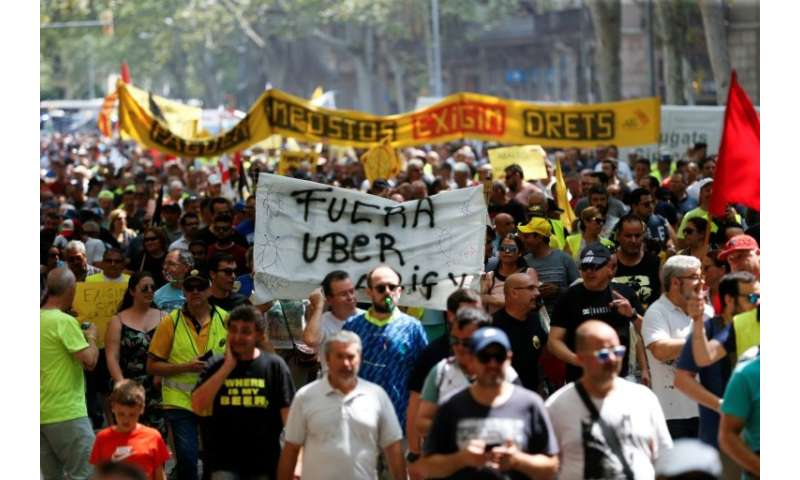 Taxi drivers march during a strike in Barcelona on July 25, 2018