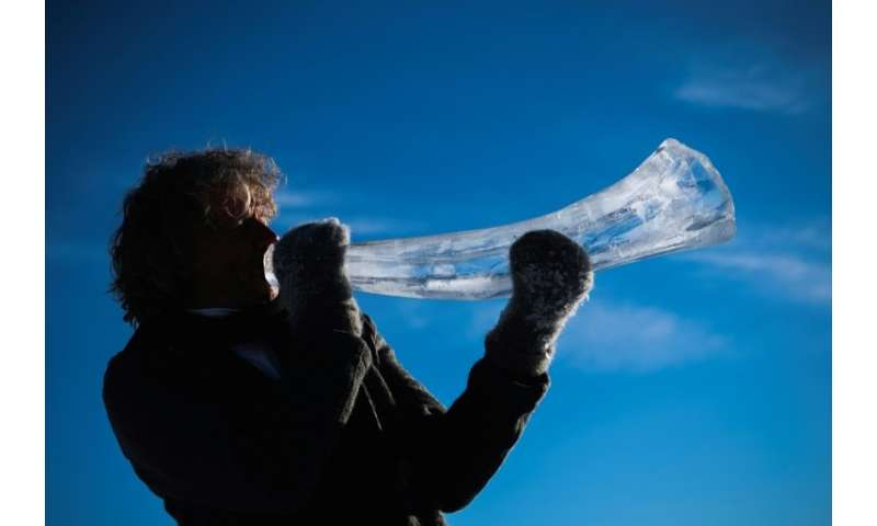 Terje Lsungset, the founder and artistic director of the Ice Music Festival, tests a musical instrument made out of ice