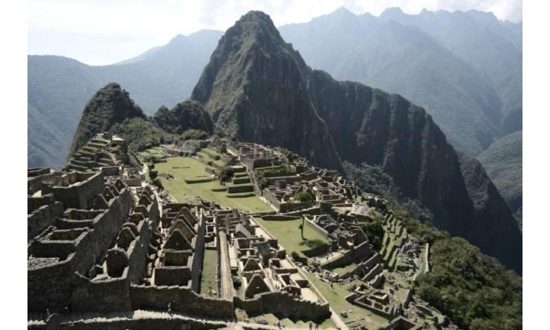 The Historic Sanctuary of Machu Picchu is embedded within a dramatic landscape at the meeting point between the Peruvian Andes a