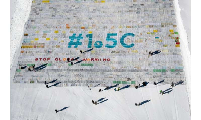 The mosaic of postcards, measuring 2,500 square metres (26,910 square feet), was laid out in the snow on the Aletsch glacier in