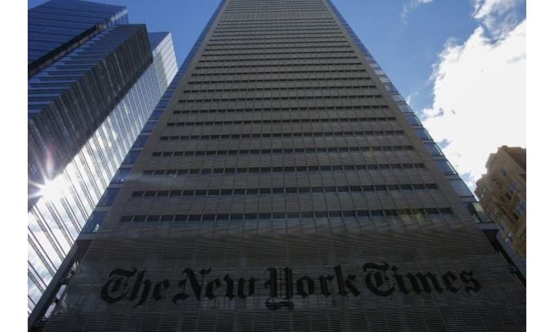 The New York Times added more digital subscriptions in the fourth quarter but swung to a loss on one-time charges