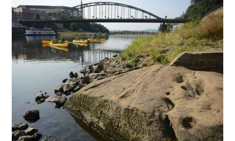 "The so-called ""Hunger Stone"" embedded deep in the Elbe River has reappeared in the Czech Republic after Europe's long,"