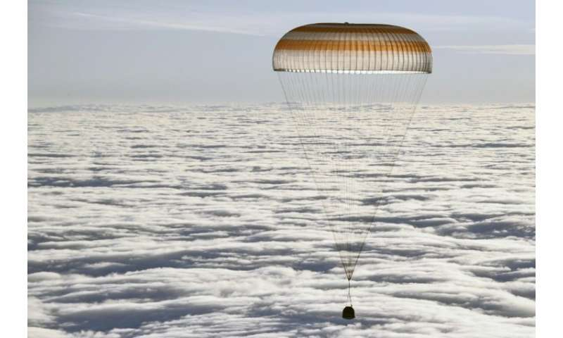 The Soyuz MS-06 space capsule carrying the ISS crew descends for its landing in a remote area of Kazakhstan