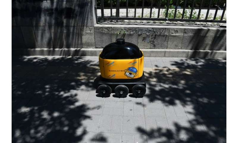 The yellow robots in Beijing's Kafka compound have little to trouble them, moving along a wide pavement with no obstacles—and no