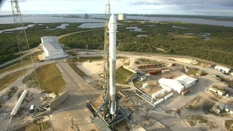 This December 2017 photo released by NASA shows a SpaceX Falcon 9 rocket with the Dragon spacecraft on Space Launch Complex 40 a