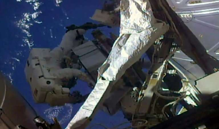 This NASA TV frame grab shows a pair of US astronauts as they began a spacewalk outside the International Space to swap and chec