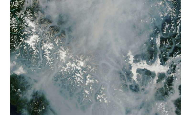 This satellite image released by the NASA Earth Observatory shows the smokey landcape of British Columbia province in southweste