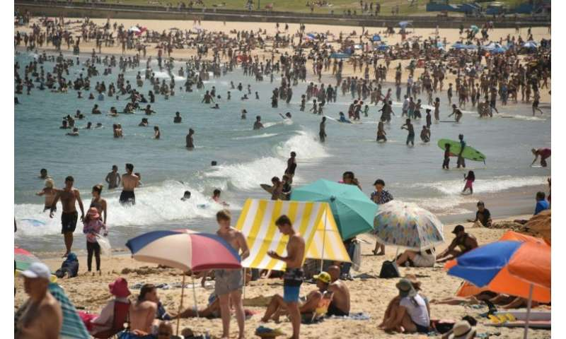 Thousands have flocked to the beach to cool down as temperatures touch 40 degrees Celsius