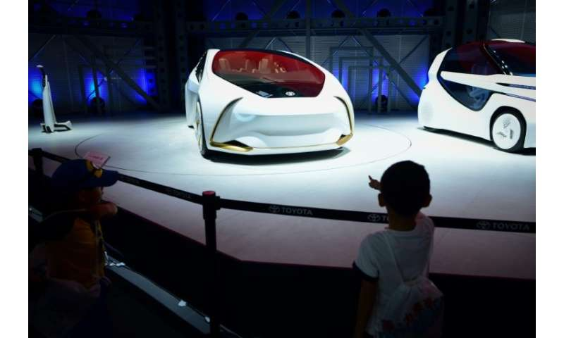 Toyota showed its i Ride concept car at the Beijing auto show, an electric vehicle with automated driving that is easy to enter