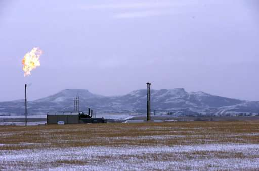 Trump rolls back pollution rules for drilling on US lands