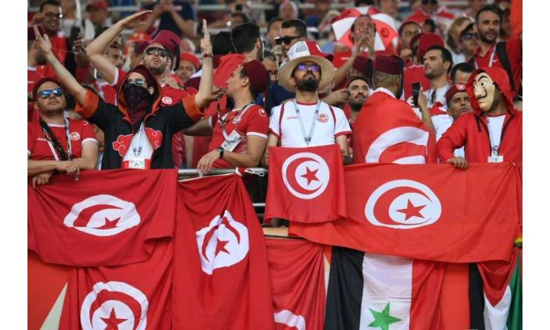 Tunisia fans cheer during a match against Belgium at the Spartak Stadium in Moscow, but some supporters back home in Africa were